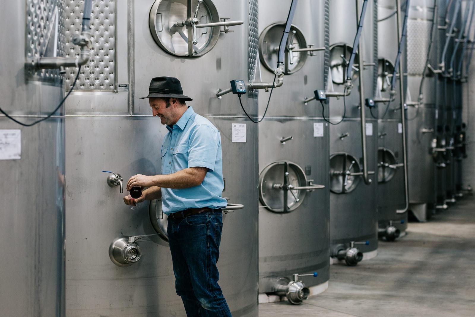 Sam Plunkett and wine vats